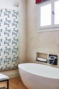Ein Badezimmer in der Unterkunft Hotel Boutique Corral del Rey