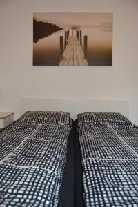 A bed or beds in a room at Aachen Apartment