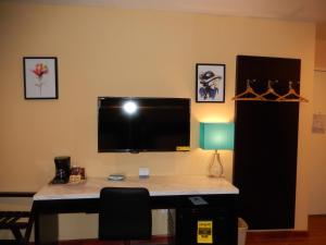 A television and/or entertainment center at Quality Inn near Sunset Park