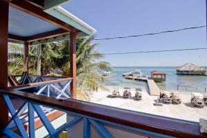 A balcony or terrace at Sandbar Beachfront Hostel & Restaurant