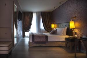 Cama ou camas em um quarto em Arcadia Boutique Hotel