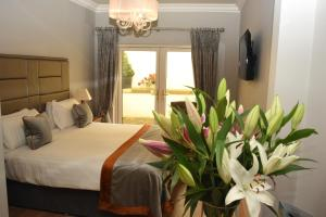A bed or beds in a room at The Fairview Boutique Hotel
