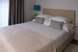 A bed or beds in a room at Quinta de Anterronde