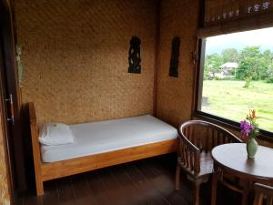 A bed or beds in a room at White Lotus