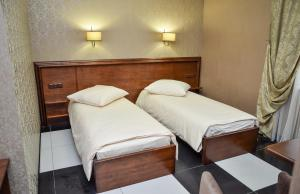 A bed or beds in a room at Nashe Misto Guest House