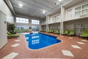The swimming pool at or near Hotel & Suites Le Dauphin Drummondville