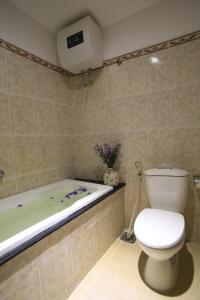 A bathroom at Acacia Heritage Hotel