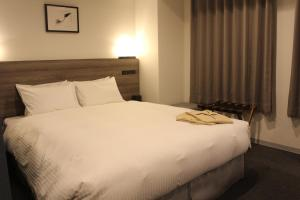 A bed or beds in a room at Best Western Sapporo Odori-Koen