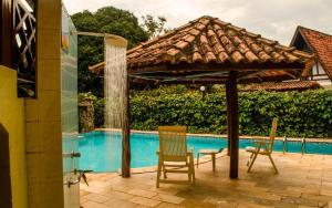 The swimming pool at or near Pauba Praia Hotel