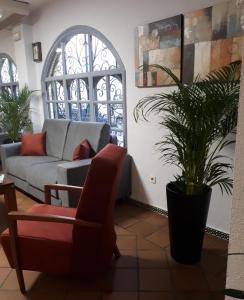 A seating area at Apartamentos Puerta del Sur