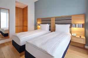 A bed or beds in a room at The Wellem, in The Unbound Collection by Hyatt