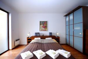 Posteľ alebo postele v izbe v ubytovaní Apartments Ski & Sun