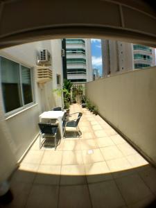 A balcony or terrace at Apartamento Balneário Camboriú