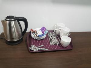 Set per la preparazione di tè e caffè presso Noclegi i Parking u Andrzeja