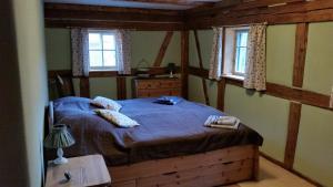 Ein Bett oder Betten in einem Zimmer der Unterkunft Am Waldessaum