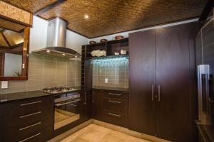 A kitchen or kitchenette at Te Manava Luxury Villas & Spa