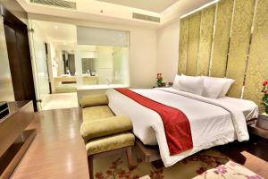 A bed or beds in a room at Hotel Royal Orchid, Jaipur