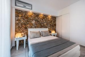 A bed or beds in a room at Gaia in Style - Adults Only