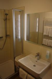 Ein Badezimmer in der Unterkunft Hotel Haus am Meer