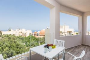 A balcony or terrace at Menta City Boutique Hotel