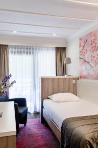 Een bed of bedden in een kamer bij Hotel Hof van Gelre