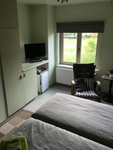 A bed or beds in a room at Logies Ternier