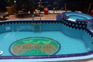 A view of the pool at Pousada das Laranjeiras or nearby