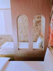Cama o camas de una habitación en Win Motel