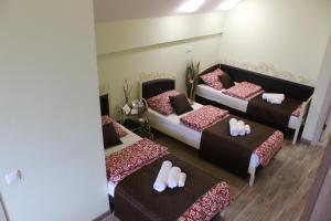 Кровать или кровати в номере Мини Отель на Ленинградской
