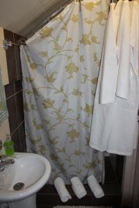 Ванная комната в Мини Отель на Ленинградской