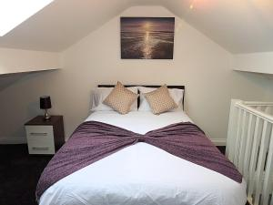 A bed or beds in a room at Parks Nest 3