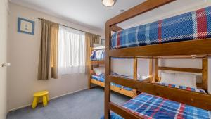 A bunk bed or bunk beds in a room at 14 Lansell Road, Cowes