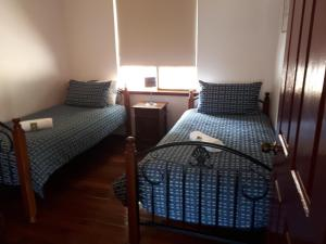 A bed or beds in a room at Walpole Wilderness Resort