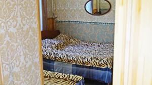 Кровать или кровати в номере Apartment Kubanskaya 3