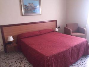 Letto o letti in una camera di Hotel La Casa Del Pellegrino