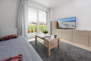 Telewizja i/lub zestaw kina domowego w obiekcie Rybacka Apartament