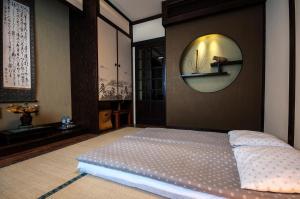 Łóżko lub łóżka w pokoju w obiekcie Villa-Japonica