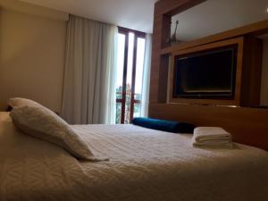 Cama ou camas em um quarto em Loft Em Pedra Azul