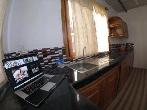 A kitchen or kitchenette at Costa Del Sol