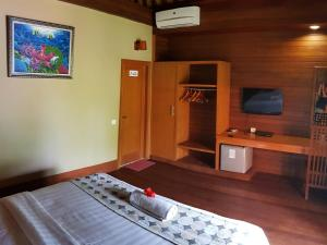 En TV eller et underholdningssystem på Kencana Garden
