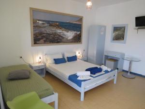 Letto o letti in una camera di Blue Beach Villas Apartments