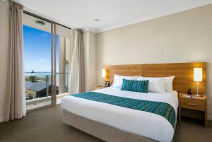 A bed or beds in a room at Quest Scarborough