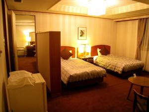 A bed or beds in a room at Hotel Marroad Hakone