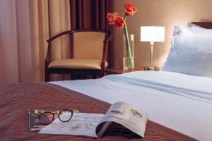 Кровать или кровати в номере РЕАВИЛЬ отель-ресторан