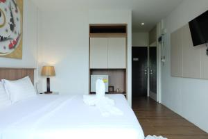 A bed or beds in a room at A Plus Hotel