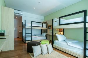A bunk bed or bunk beds in a room at Yan's House Hotel