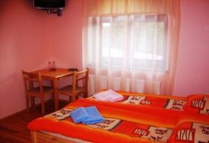 A bed or beds in a room at Vētrasputns