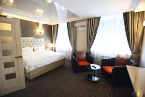 Кровать или кровати в номере Hotel Zolotoy Drakon