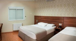 A bed or beds in a room at Hotel Kindermann