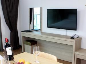 A television and/or entertainment center at The Blue Jeju